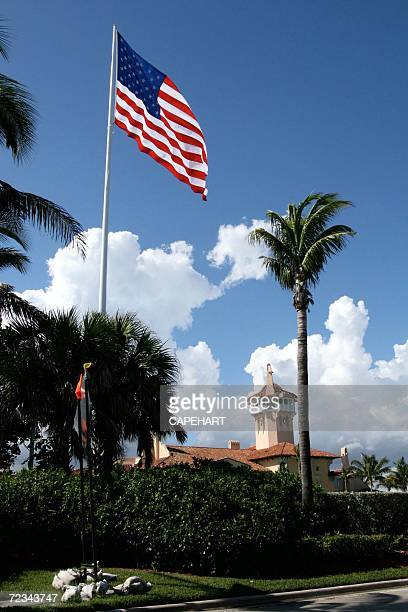 An American flag flies over Donald Trump's MarALago club on November 1 2006 in Palm Beach Florida The town of Palm Beach has cited Donald Trump...