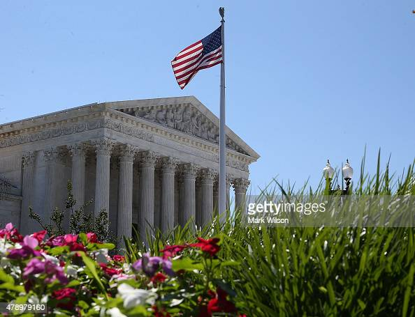 An American flag flies over the US Supreme Court June 29 2015 in Washington DC Today the high court ruled on the controversial drug that was...