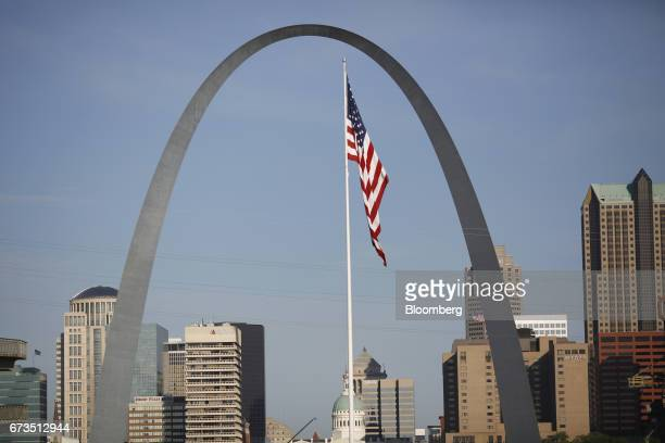 An American flag flies past the Gateway Arch in East St Louis Illinois US on Tuesday April 25 2017 Union Pacific Corp is scheduled to release...