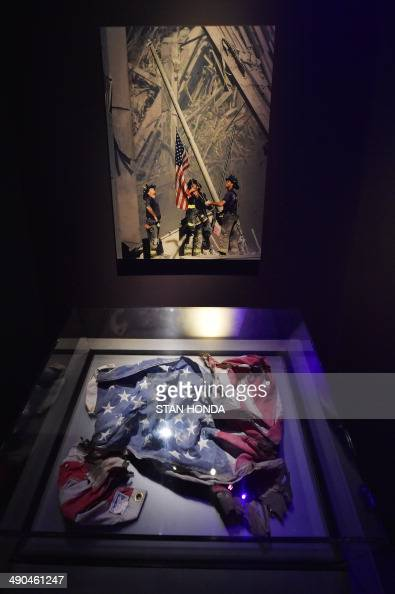 An American flag found at the World Trade Center site and a photograph of a flag raising at the site by Thomas E Franklin/The Record seen during a...