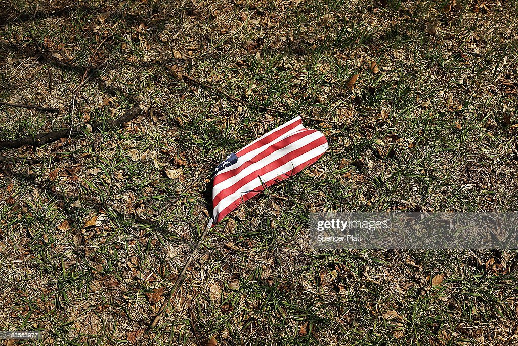 An American flag from the grave of a man who served in the American Civil War is viewed at Green-Wood Cemetery on the 149th anniversary of the ending of the Civil War on April 9, 2014 in the Brooklyn borough of New York City. Green-Wood Cemetery holds over 5,000 veterans of the war, including 75 Confederates and women who served as nurses. While New York was not the sight for any Civil War battles, it was home to numerous arms manufacturers, Confederate prisons, tens of thousands of volunteers and was a major center for the financing to the Union Army. The Civil War ran from 1861 to 1865.