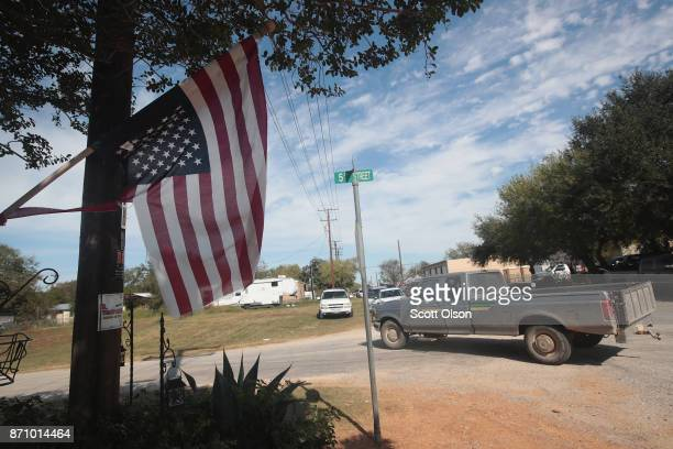 An American flag hags upside down from a home near the First Baptist Church of Sutherland Springs on November 6 2017 in Sutherland Springs Texas On...