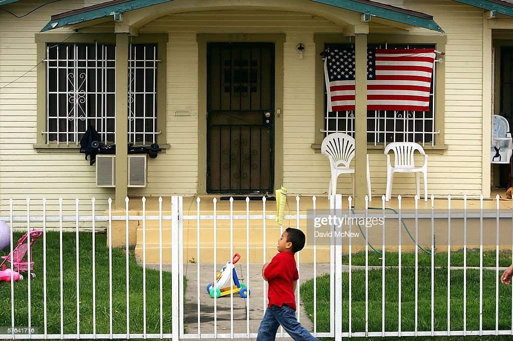 An American flag hangs on a single-family home in this Latino neighborhood May 17, 2006 in the Los Angeles-area city of Maywood, California. In November, voters, angered that city police were stopping and seizing hundreds of cars whose unlicensed drivers frequently turned out to be illegal immigrants, elected a new majority on the city council. The new council majority promptly voted to eliminate the police department's traffic division, resulting in car impoundments dropping from 240 a month to 40. The city in January also officially opposed a proposed federal law that would have criminalized illegal immigration and forced local police to enforce immigration law. Approximately 96 percent of the city's 29,000 residents is Latino, with an additional 10,000 illegal residents living within city limits, according to estimates.