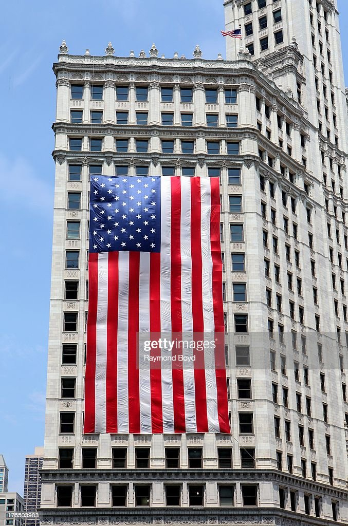 An American Flag hangs outside the Wrigley Building, in Chicago, Illinois on JULY