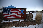 An American flag hangs over a sign in front of the Malheur National Wildlife Refuge Headquarters on January 5 2016 near Burns Oregon An armed...
