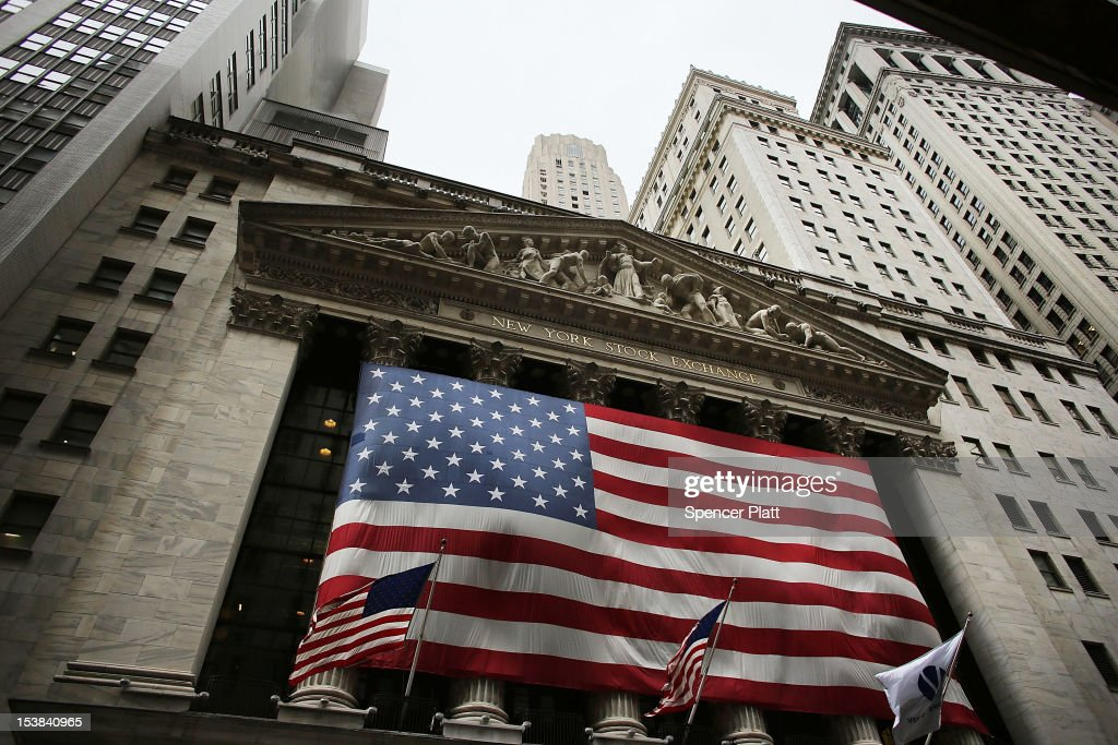An American flag hangs over the New York Stock Exchange on October 9, 2012 in New York City. State Comptroller Thomas DiNapoli will release his annual report on employment and earnings October 9, in New York' City's financial industry, one of the worlds largest. While employment is still down thousands of positions since the economic crisis of 2008, DiNapoli has said that last year the sector employed 166,600 people in hedge funds, investment banks and securities trading firms.