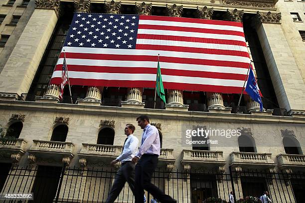 An American flag hangs over the New York Stock Exchange on September 15 2015 in New York City Stocks ended up today with the Dow Jones industrial...
