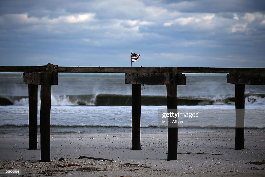 An American flag is attached to the boarwalk damaged by Superstorm Sandy, on November 24, 2012 in Ortley Beach, New Jersey. New Jersey Gov. Christie estimated that Superstorm Sandy cost New Jersey $29.4 billion in damage and economic losses.