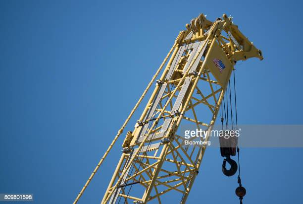 An American flag is displayed on a shipping crane at Port Canaveral in Cape Canaveral Florida US on Wednesday July 5 2017 The US Census Bureau...