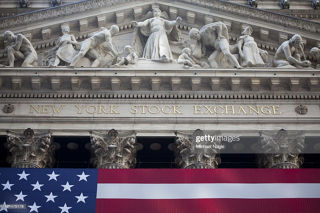 An American flag is displayed on the front of the New York Stock Exchange on August 19, 2011 in New York City. The Dow ends another volatile week, closing more than 100 points Down for the day.