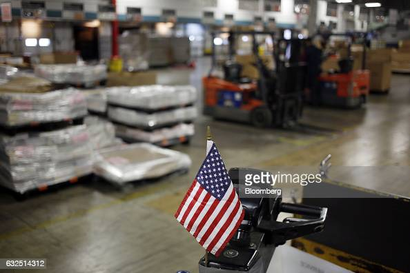 An American flag is displayed on the loading dock at the United States Postal Service sorting center in Louisville Kentucky US on Friday Jan 13 2017...