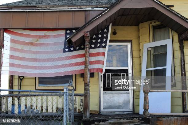 An American flag is on display at a residence near downtown on July 6 2017 in Butte Montana Butte is home to the toxic Berkeley Pit Formerly an open...