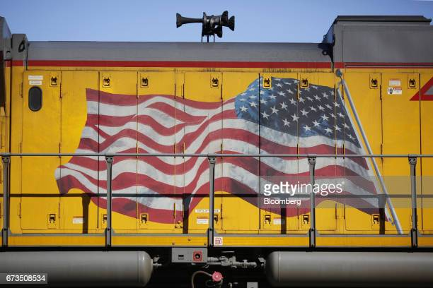 An American flag is painted on the side of a Union Pacific Corp freight locomotive in St Louis Missouri US on Tuesday April 25 2017 Union Pacific...