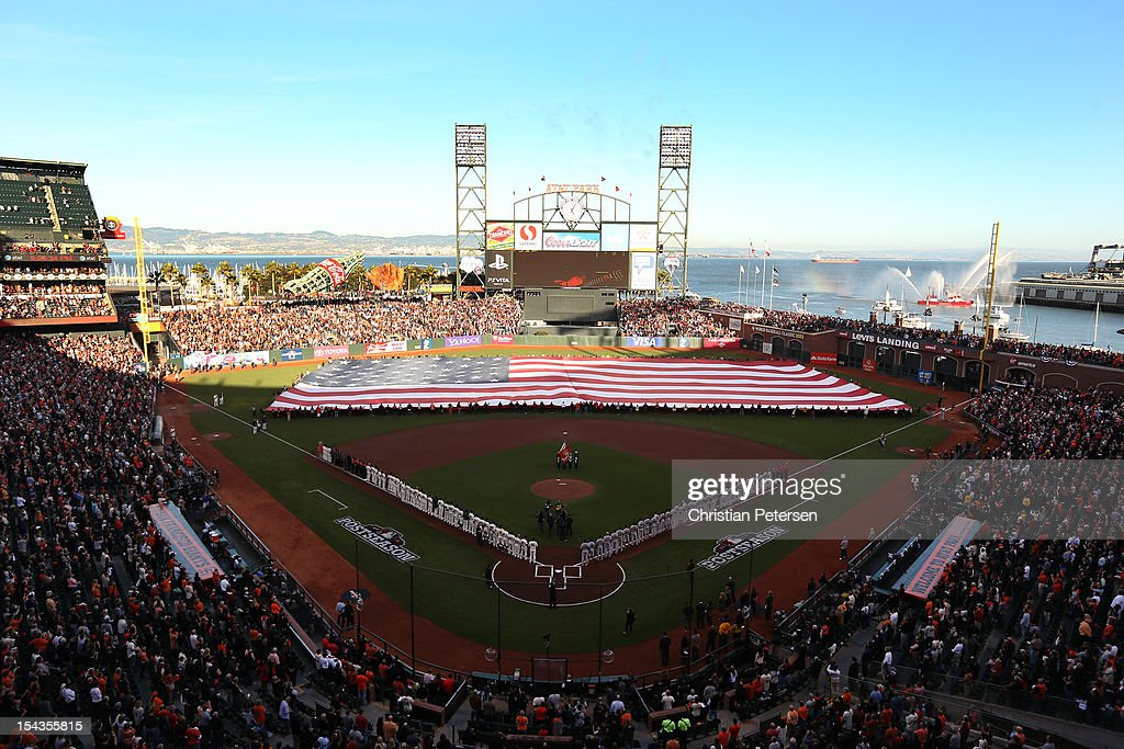 An American flag is presented during pre-game ceremonies for Game One of the National League Championship Series between the San Francisco Giants and the St. Louis Cardinals at AT&T Park on October 14, 2012 in San Francisco, California.