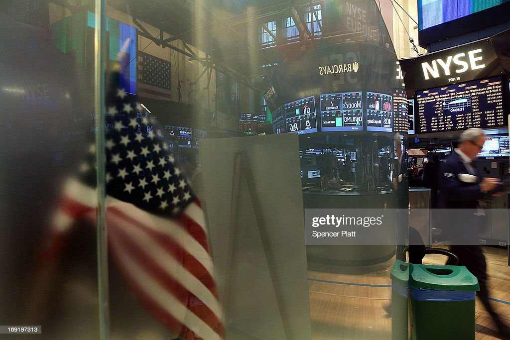 An American flag is seen as traders work on the floor of the New York Stock Exchange on May 21, 2013 in New York City. Following comments from a Federal Reserve official indicating that the central bank will continue to flow money into the financial system, stocks rose Tuesday with the Dow Jones industrial average closing up 52.20.