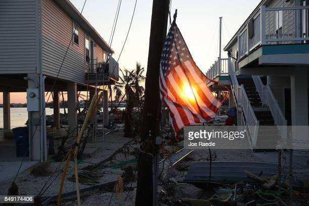 An American flag is seen attached to a electric pole as people begin the process of rebuilding after hurricane Irma passed through the area on...