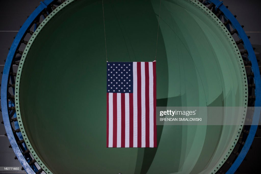 An American flag is seen in the bow portion of a submarine before US President Barack Obama speaks during an event at Newport News Shipbuilding on February 26, 2013 in Newport News, Virginia. Obama traveled to Virginia to tour Newport News Shipbuilding and speak about the effects of the effects of the upcoming sequester's budget cuts on the defense industry and US economy. AFP PHOTO/Brendan SMIALOWSKI