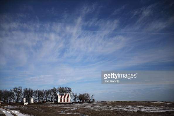 An American flag is seen painted on a barn on January 30 2016 outside of Des Moines Iowa Candidates who are seeking the nominations from the...