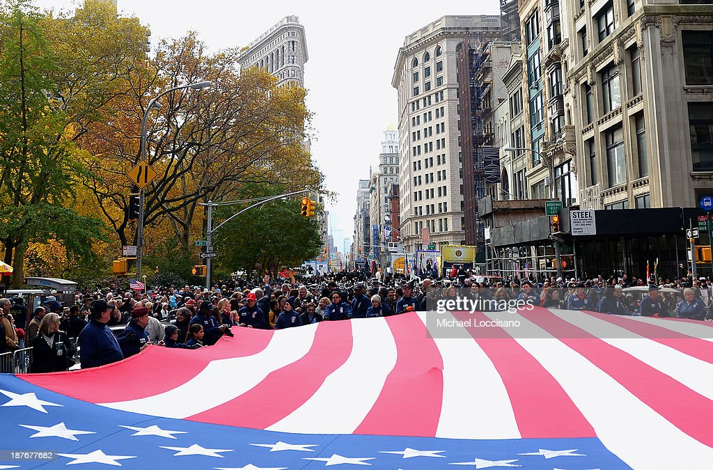 An American flag is stretched and walked throughout the 94th annual New York City Veterans Day Parade on 5th Avenue on November 11, 2013 in New York City. The parade is the largest of its kind in the country and this year is especially dedicated to women serving in the armed forces.