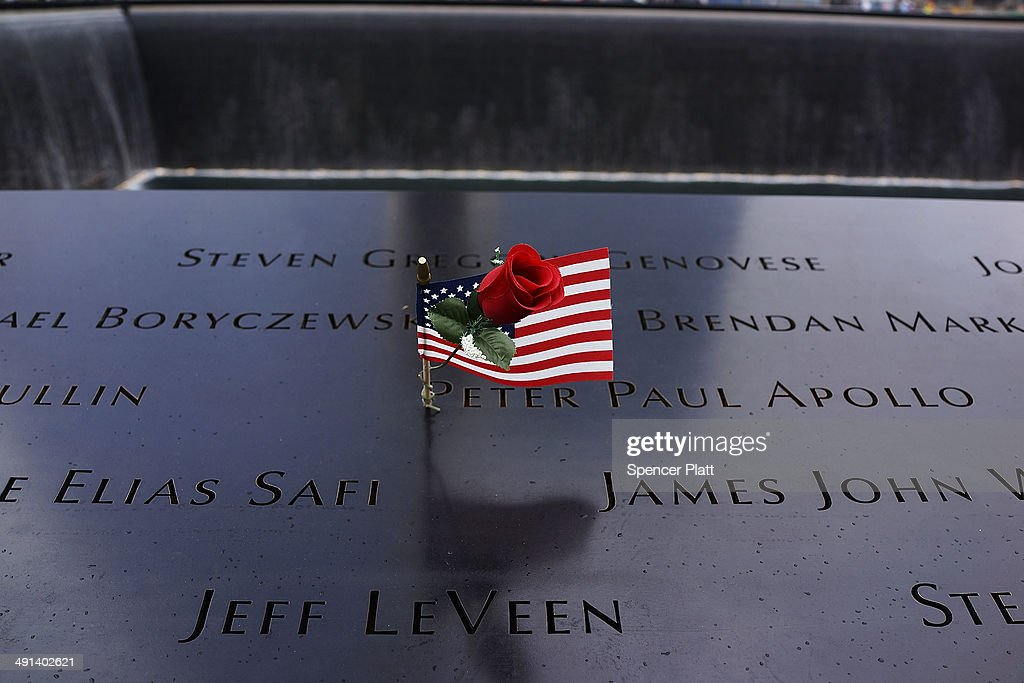 An American flag is viewed on a persons name along a reflecting pool at the ground zero memorial site after authorities opened the plaza to the public free of charge on May 16, 2014 in New York City. Prior to today, visitors had to wait in line to enter a barricaded area which includes the newly dedicated National September 11 Memorial Museum. Together with the museum, Ground Zero has become one of the top tourist attractions in the nation with tens of thousands of visitors expected yearly.