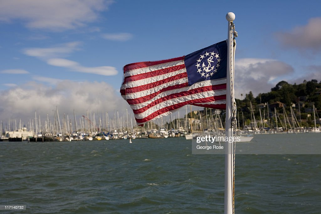 An American flag mounted on the bow of a tour boat whips in the wind as the fog and clouds roll across the Sausalito Marina on June 11, 2011 in Sausalito, California. The San Francisco Bay is home to thousands of sailing enthusiasts and will be the site of the 2013 America's Cup.