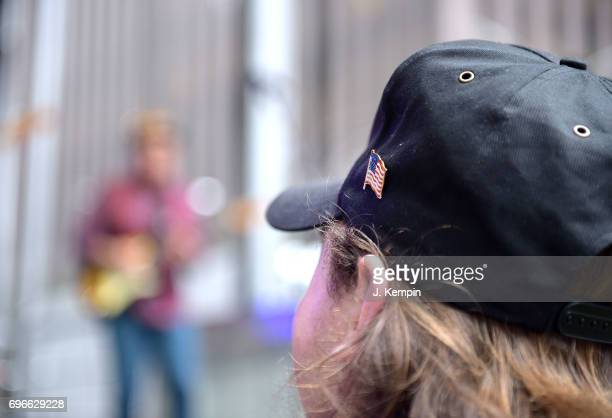 An American flag pin is seen on a fans hat at Charlie Daniels's performance on Fox Friends' AllAmerican Summer Concert Series at FOX Studios on June...