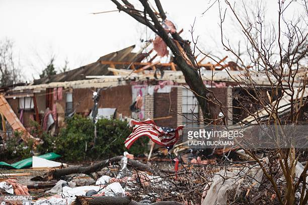 An American flag placed by first responders is seen December 27 2015 in the aftermath of a tornado in Rowlett Texas At least 11 people lost their...