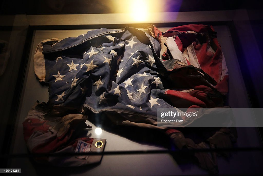 An American Flag recovered from the World Trade Center site is viewed during a preview of the National September 11 Memorial Museum on May 14, 2014 in New York City. The long awaited museum will open to the public on May 21 following a six-day dedication period for 9/11 families, survivors, first responders ,workers, and local city residents. For the dedication period the doors to the museum will be open for 24-hours a day from May 15 through May 20. On Thursday President Barack Obama and the first lady will attend the dedication ceremony for the opening of the museum. While the construction of the museum has often been fraught with politics and controversy, the exhibitions and displays seek to pay tribute to the 2,983 victims of the 9/11 attacks and the 1993 bombing while also educating the public on the September 11 attacks on the World Trade Center, the Pentagon and in Pennsylvania.
