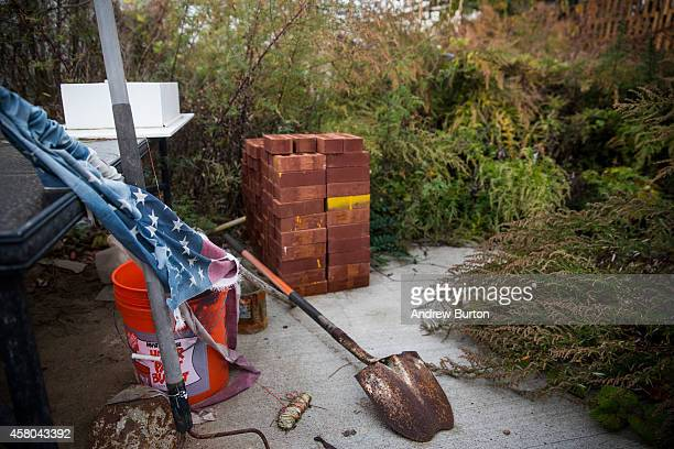 An American flag shovel and pile of bricks sits in an empty lot two years after Superstorm Sandy destroyed the house that sat on this lot on October...