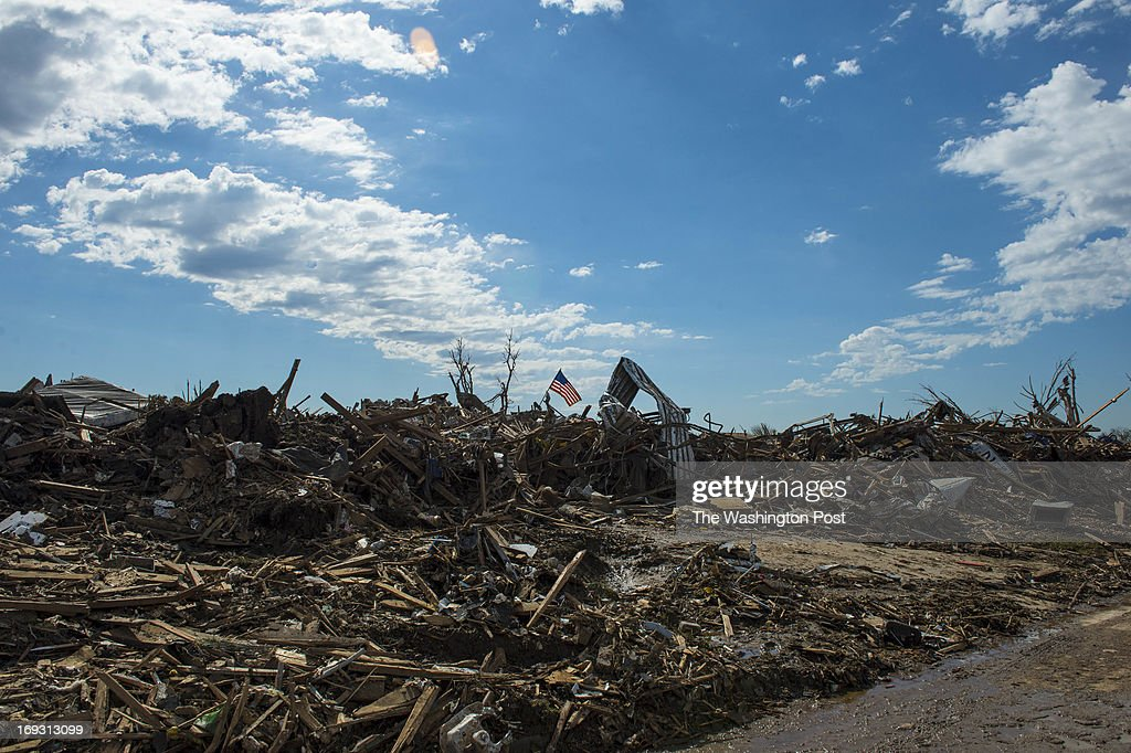 An American Flag sits on a pile of tornado debris on May 22, 2013 in Moore, Ok.