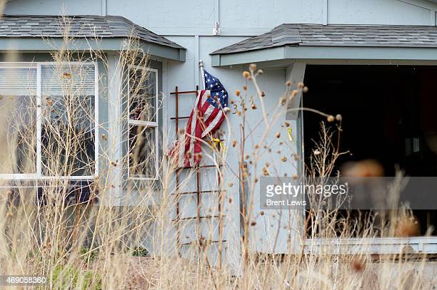 An American flag sticks out of a house along Park Street that is waiting to be either rebuilt Wednesday April 12015 in Lyons Colorado The 2013 flood...