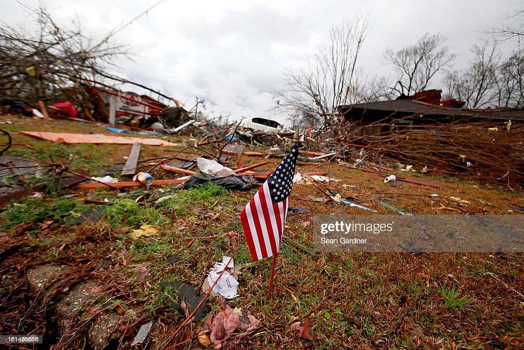An American flag was placed in front of the American Red Cross Building after a tornado touched down yesterday evening February 11, 2013 in Hattiesburg, Mississippi. Hundreds of homes were destroyed and over sixty people injured when the tornado ripped through the town.