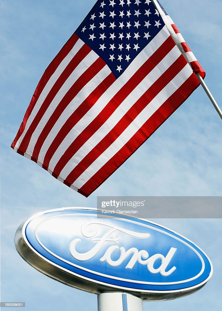 An American flag waves in front of a Ford dealership sign on January 29, 2013 in Glendale, California. According to reports the nation's second-largest automaker earned $1.7 billion in the fourth-quarter quarter, the highest pre-tax profit in a decade, up 55% from a year earlier. For the year, earnings slipped 5% to $5.7 billion.