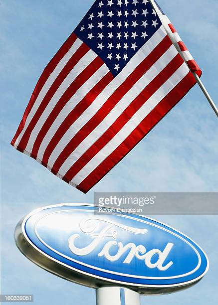 An American flag waves in front of a Ford dealership sign on January 29 2013 in Glendale California According to reports the nation's secondlargest...