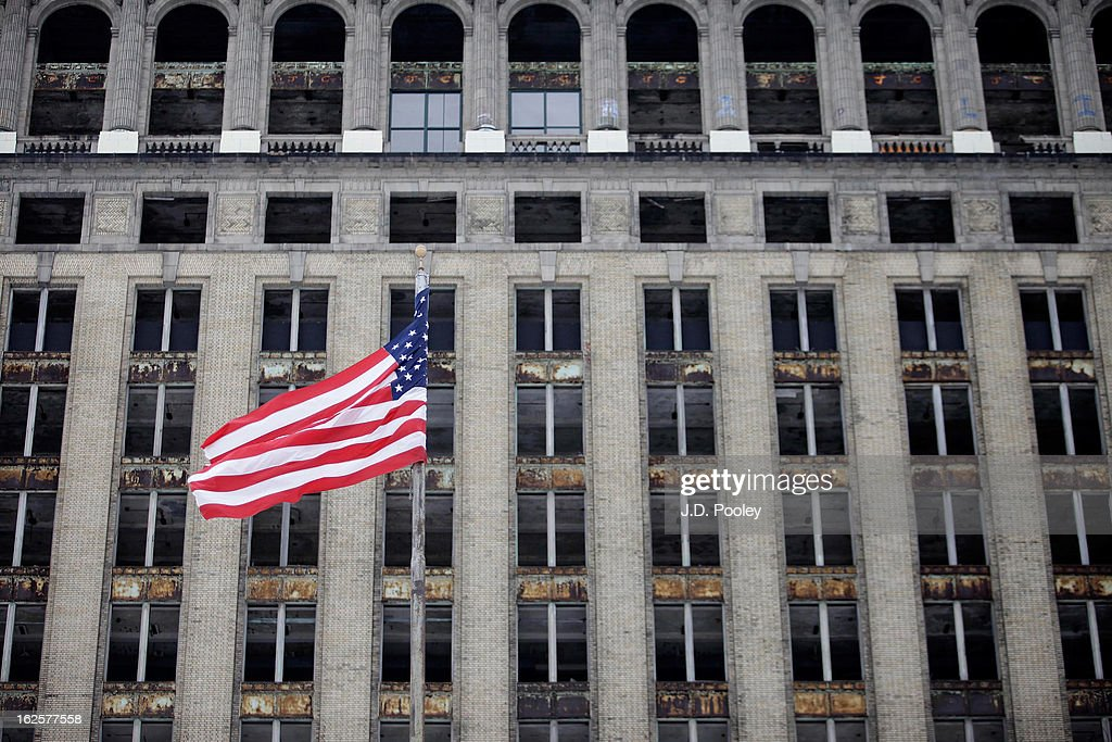 An American flag waves in the wind in front of the former Michigan Central Station February 24, 2013 in Detroit, Michigan. The city of Detroit has faced serious economic challenges in the past decade, with a shrinking population and tax base while trying to maintain essential services. A financial review team issued a finding on February 19 identifying the city as being under a 'financial emergency.' Michigan Gov. Rick Snyder has 30 days from the report's issuance to officially declare a financial emergency, which could result in the governor appointing an emergency financial manager to oversee Detroit's municipal government.