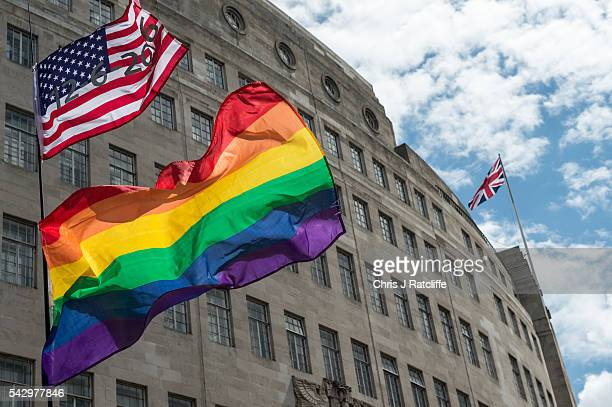 An American flag with the date of the Orlando shotings flies next to rainbow flags and a Union Jack behind as the LGBT community celebrates Pride in...