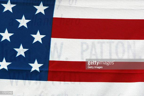 An American flags hangs at a ceremony for American pilot Lt William Wyatt Patton Jr whose remains were found more than a halfcentury after his death...
