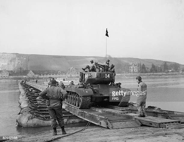 An American M26 Pershing heavy tank crosses the Rhine on a pontoon bridge near Oppenheim Germany 20th March 1949 The bridge was built by the 1st...