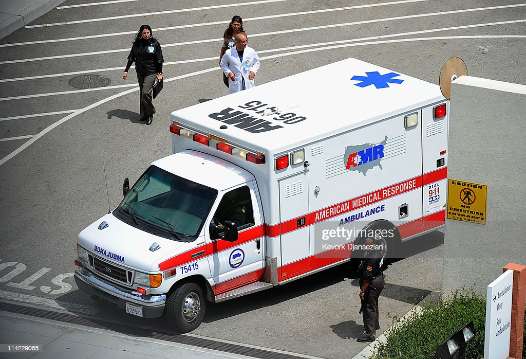 An American Medical Response ambulance with Bryan Stow aboard is transported from Los Angeles County-USC Medical Center to Bob Hope Airport for a trip to San Francisco General Hospital, as his neurosurgeon Dr. Gabriel Zada looks on May 16, 2011 in Los Angeles, California. Stow, a San Francisco Giants fan from Santa Cruz, California, was beaten at the Los Angeles Dodgers parking lot after the opening day game against the San Francisco Giants almost six weeks ago.