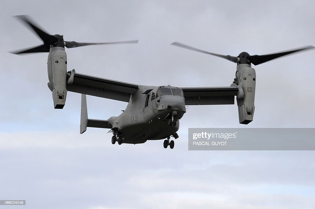 An American multi-mission and tiltrotor aircraft MV-22 Osprey, is pictured during a Franco-American military exercise called 'Garrigues Fury 2014' with soldiers of the US Special Purpose Marine Air Ground Task Force for Crisis Response, (SPMAGTF-CR), and soldiers of the French 21st Marine Infantry Regiment (RIMa) on February 13, 2014 at the military camp of Garrigues, near Nimes, southern France. The SPMAGTF-CR, was created after the armed attack against the U.S. consulate in Benghazi, Libya, in September 2012, in which four people, including the U.S. ambassador, perished. The mission of SPMAGTF-CR is to intervene rapidly in Africa. The objective of the exercise is to share the techniques and methods of action used in urban warfare. A