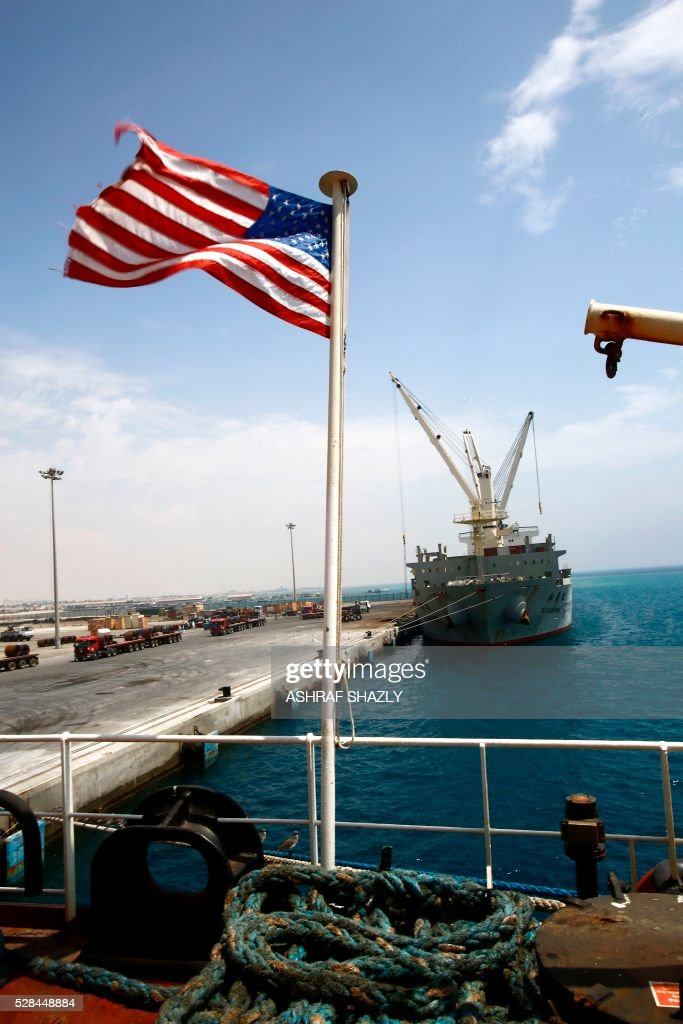 An American national flag is seen on a US aid ship carrying food supplies at Port Sudan on the Red Sea coast, on May 5, 2016. Dockers began unloading tens of thousands of tonnes of food from a US aid ship destined for war-torn areas of Sudan, an AFP correspondent reported. The bulk carrier Liberty Grace docked in Port Sudan with a cargo of 47,500 tonnes of sorghum, a staple food in Sudan. SHAZLY