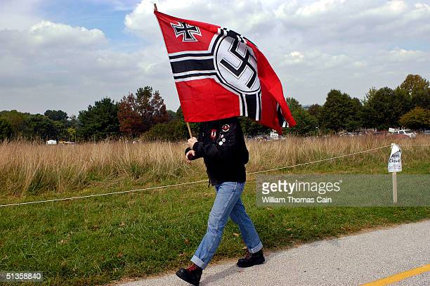 An American Nazi party member arrives carrying a Nazi flag for an American Nazi rally at Valley Forge National Park September 25 2004 in Valley Forge...