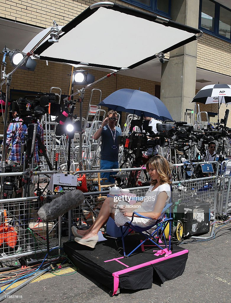 An American Network Broadcaster waits in a Union Jack chair outside the Lindo wing of St Mary's Hospital as the UK prepares for the birth of the first child of The Duke and Duchess of Cambridge on July 16, 2013 in London, England.