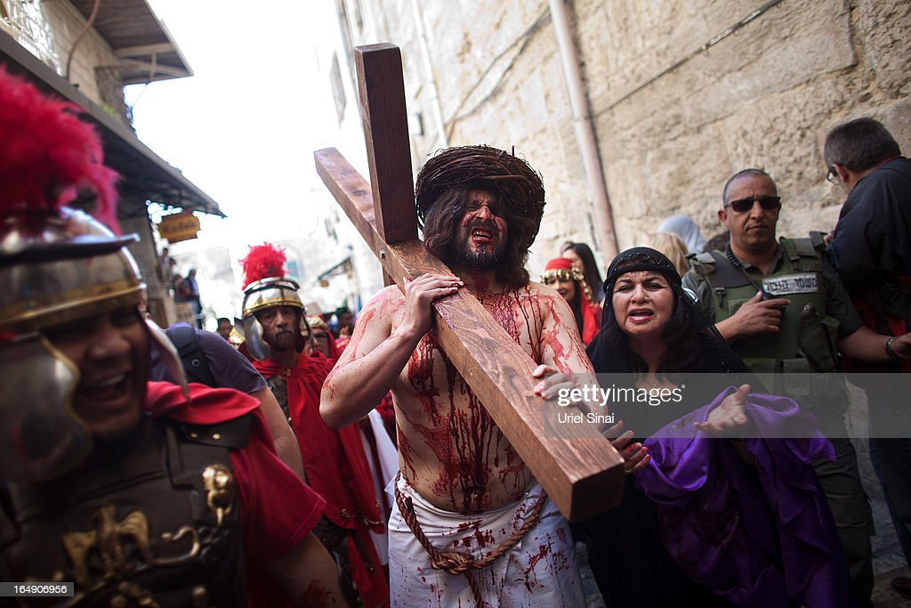 An American pilgrim from 'The Hope of Glory' order reenacts the Passion of Christ along the Via Dolorosa during the Good Friday procession on on March 29, 2013 in Jerusalem's Old City, Israel. Good Friday is celebrated by Christians throughout the world as the day Christ was crucified on the cross in the lead up to his resurrection on Easter.