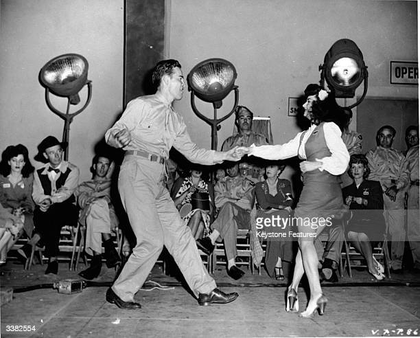 An American serviceman dancing the jitterbug with a young woman