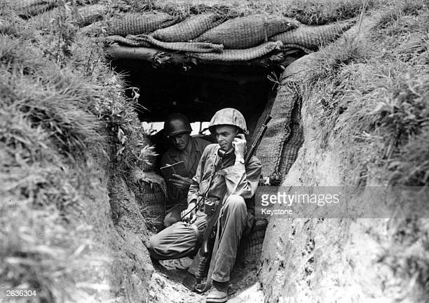 An American soldier from South Carolina reports from a field post 'somewhere in Korea' where the Southern Koreans and forces of the United States are...