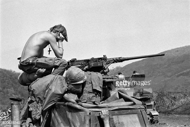 An American soldier holds his head in his hands on Easter Sunday while sitting on top of a tank near Khe Sanh during the Vietnam War April 4 1971