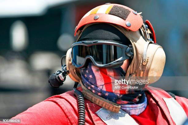 An American soldier is seen during a visit on the US aircraft carrier USS George H W Bush as it docks at the Haifa port on July 3 2017 / AFP PHOTO /...