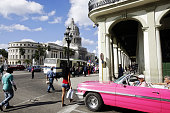 An American vintage car drives in front of the Capitolio shortly after a live broadcast a speech by Cuban President Raul Castro about the...