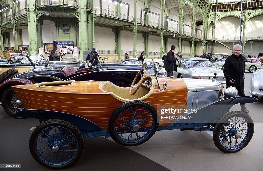 An Amilcar Type 4C Skiff (1922) is pictured as luxury vintages cars are displayed at an auction at the Grand Palais on February 6, 2013 in Paris. 125 vintage motor cars, 100 collection motorbikes and a 1920's Gipsy Moth plane by De Havilland, will be presented at the Bonhams auction on February 7.